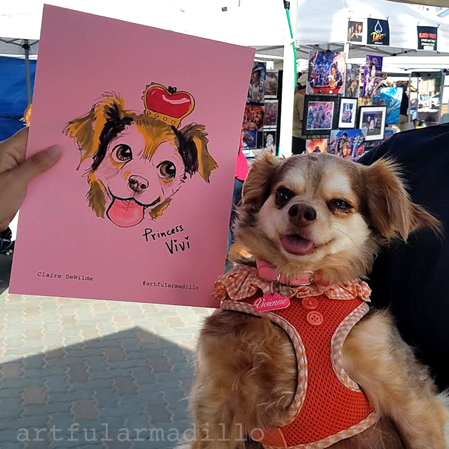 Princess Vivi poses with her caricature
